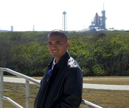 Posing in front of space shuttle Discovery on its pad at Launch Complex 39A.