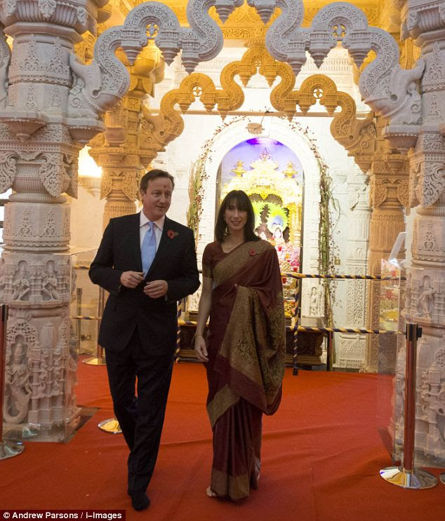 42-year-old Samantha chose a russet-coloured sari edged in gold for a visit to the Swaminarayan Mandir, the largest traditional Hindu temple outside India, at Neasden in north-west London