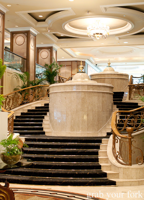 Staircase, fountains and chandeliers at The Langham Hotel Melbourne