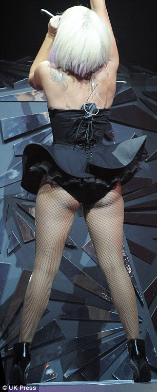 Meaty: Lady Gaga showed off a more curvaceous figure than normal in a carnivorous corset as she performed in Bucharest, Romania, seen right in March 2009 looking trimmer