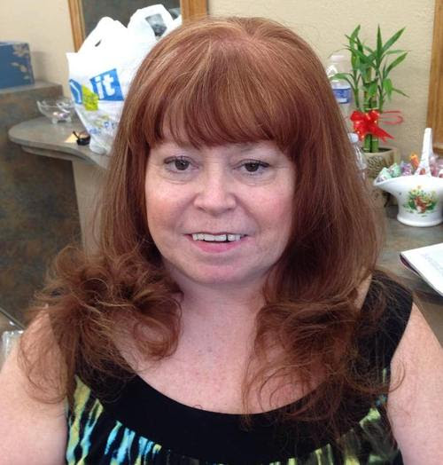 long hairstyle with bangs for women over 50