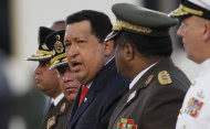 Venezuela's President Hugo Chavez, center, attends a military ceremony marking the 75th anniversary of the creation of the Bolivarian National Guard at Fuerte Tiuna military base in Caracas, Venezuela, Friday, Aug. 10, 2012. (AP Photo/Ariana Cubillos)