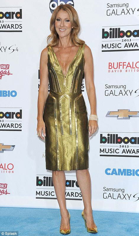 Golden girl: Celine Dion, 45, took the plunge in a shiny gold mini-dress and gold pumps