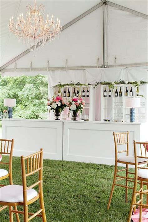 White wooden bar with crystal chandelier. Coral flowers
