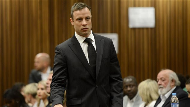 Oscar Pistorius, écoutant le prononcé de sa sentence