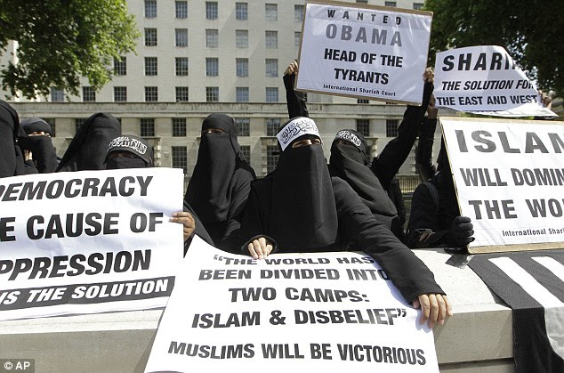 Angry Muslims: Women wearing veils display placards against Obama and democracy outside Downing Street