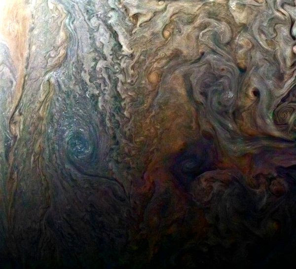Jupiter's cloud tops as seen by NASA's Juno spacecraft from a distance of 9,000 miles (14,500 kilometers)...on February 2, 2017.