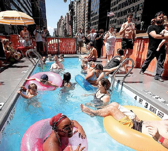 Portable pool crafted from an old dumpster, New York City.