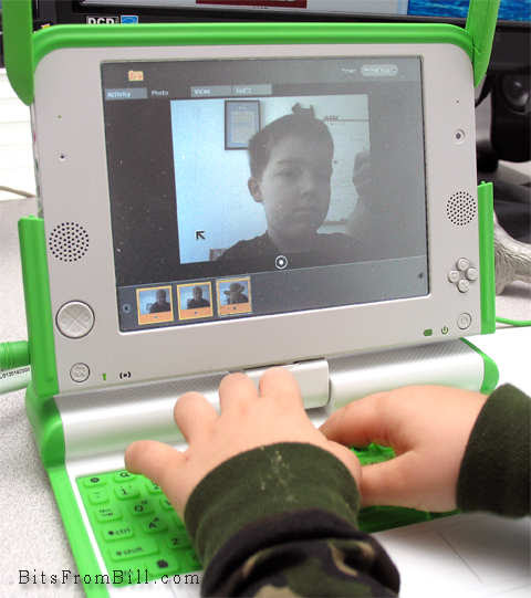 Tristan taking his photo with the OLPC