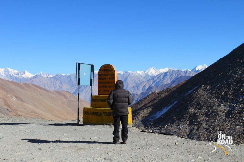 Next to a Khardungla sign board at 18,380 feet above MSL