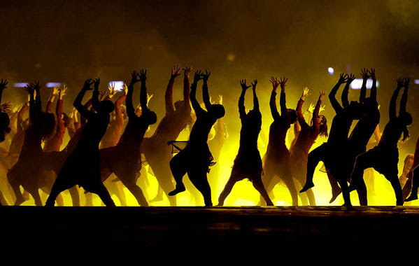 Dancers are seen in silhouette as they perform during the opening ceremony at the 2012 London Olympics on Friday.