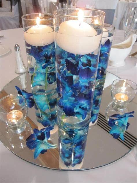 Blue orchid centerpiece .the mirror at the bottom