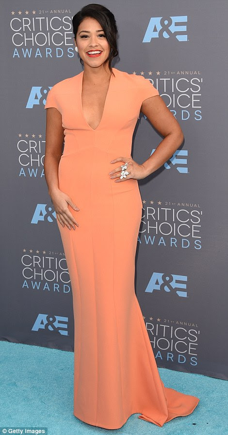 Just peachy: Hayden Panettiere showed plenty of cleavage in a blush-coloured Maria Lucia Hohan gown, while Gina Rodriguez wore a salmon SAFiYAA dress