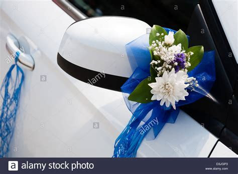 Wedding car decoration with flowers and ribbons Stock