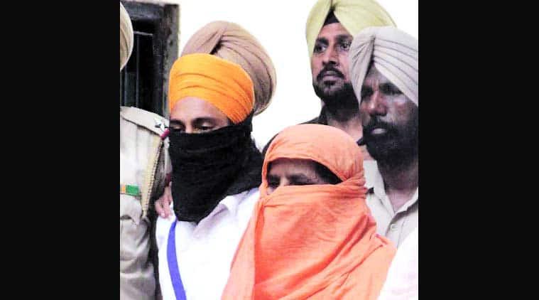 The two suspects in police custody in Ludhiana Monday.  (Gurmeet Singh)