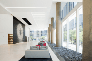 The lobby of the new KPMG Plaza building displays Dallas Rag, a 43-by-30-foot (13 by 9 m) artwork created in situ by the renowned British artist Richard Long in summer 2015. (© Hall Group)
