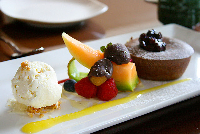 Chocolate Lava Cake - freshly baked, and accompanied by vanilla ice cream and fruit