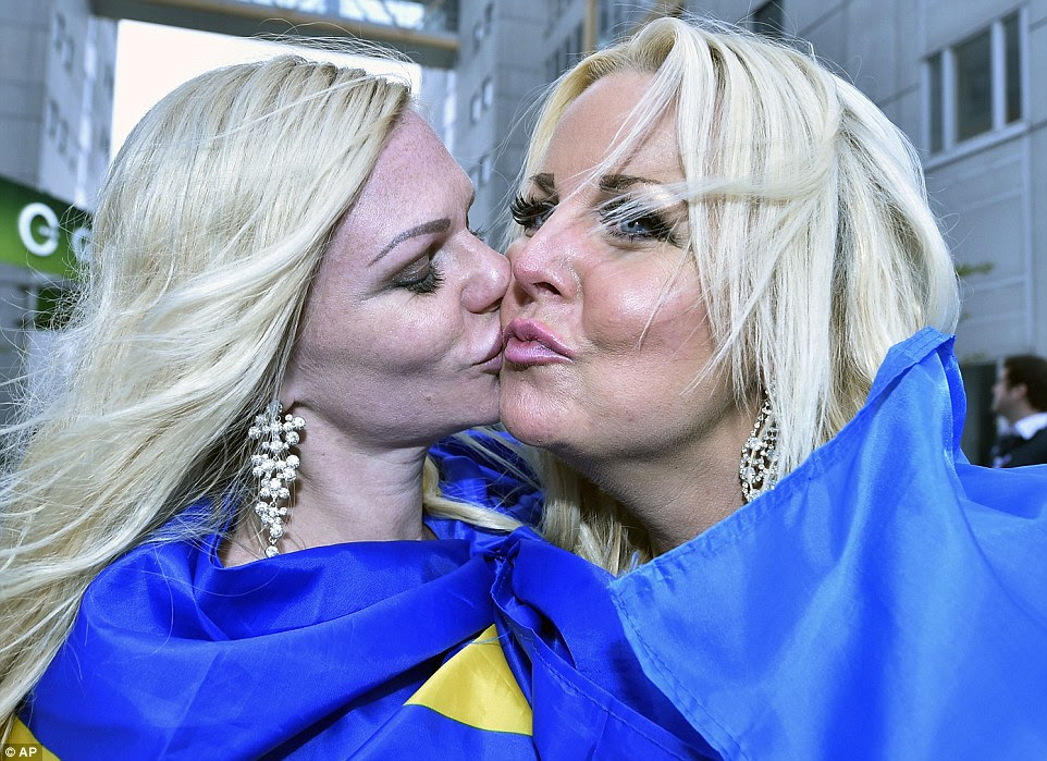 Pucker up! Two female fans from Sweden shared a kiss as they showed their support for the song contest's host country