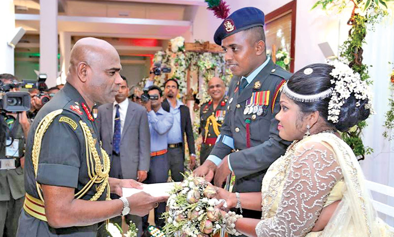 Three more differently-able War Heroes of the Vijayabahu Infantry Regiment (VIR) tied the nuptial knot at VIR-managed 'The Salute' Reception Hall at Boyagane, Kurunegala on Tuesday. Here, Army Commander Lt.General Mahesh Senanayake who was the Chief Guest on this occasion having a word with one of the newly married couples. Picture courtesy Army Media Unit