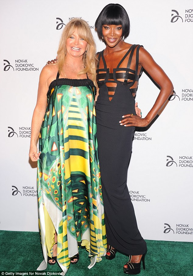 New BFFs: Goldie and Naomi Campbell posed happily together on the green carpet at the event