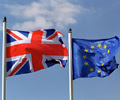 A United Kingdom flag flying next to a European Union flag