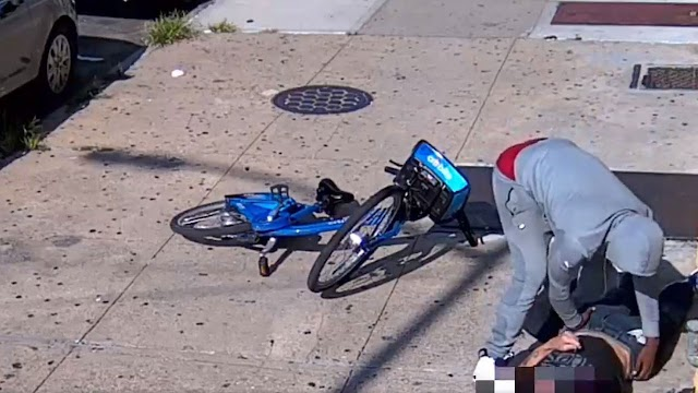 NYC robbery suspect seen rifling through unconscious man's pockets after brazen daylight beat down