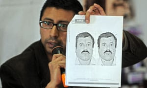Wanted: the Guatemalan migration director shows a picture of Guzman during a press conference in Guatemala City
