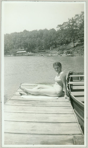 girl on dock with two piece bathing suit