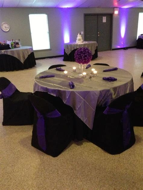 Purple, black, silver table decoration.   This and that