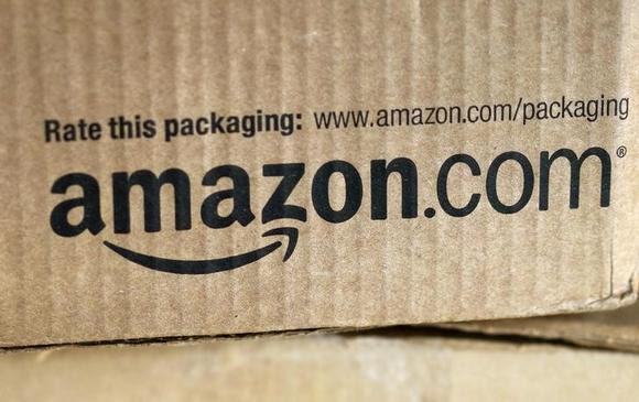 A just-delivered Amazon box is seen on a counter in Golden, Colorado August 27, 2014. REUTERS/Rick Wilking/Files