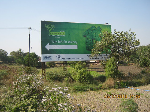 Hoarding of Alfa Green Fields - 1 BHK, 2 BHK, 2.5 BHK, 3 BHK Flats & 3 BHK, 4 BHK Villas, behind First Flight Couriers, on Old Mumbai Pune Highway (NH4), Wadgaon Maval, near Talegaon MIDC, Pune 412 106
