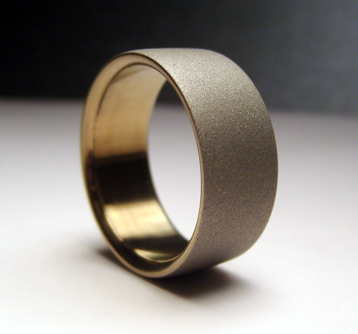 Gold and gray. wide. titanium band