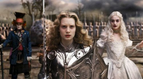 The Mad Hatter and the White Queen (Anne Hathaway) watch as Alice marches off to battle in ALICE IN WONDERLAND.