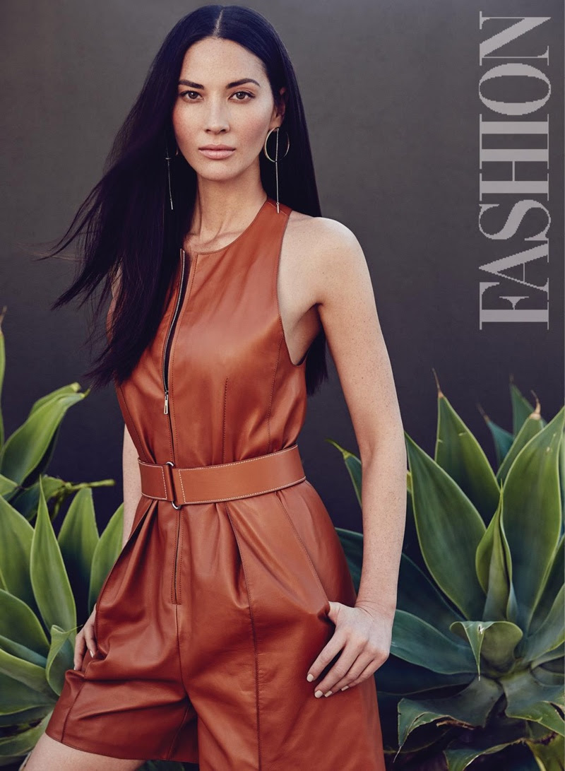 Olivia Munn strikes a pose in a leather Hermes romper and Jenny Bird hoop earrings