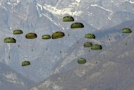 US paratroopers are dropped by a US airforce C17 (not pictured) during a training exercise over Maniago near Aviano air base in 2011. US and South Korean special forces have been parachuting into North Korea to gather intelligence about underground military installations, a US officer has said in comments carried in US media. (AFP Photo/Giuseppe Cacace)