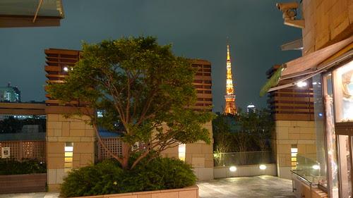 Tokyo Tower behind a Roppongi Hills shop