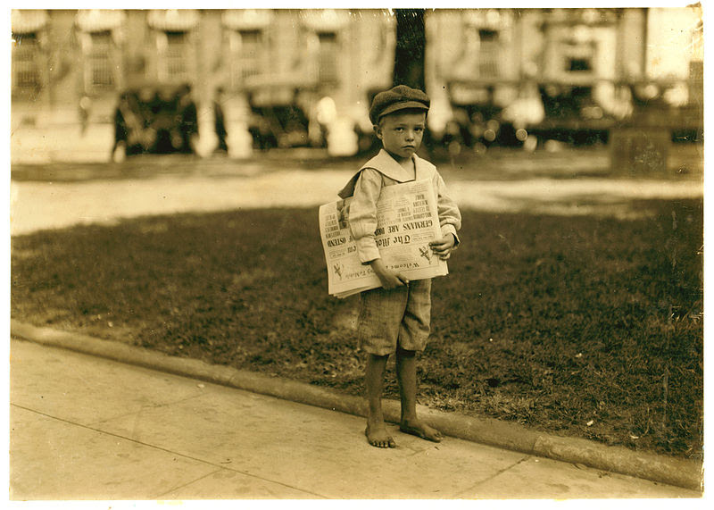"""7-year-old newsie."" By Lewis Hine [Public domain], via Wikimedia Commons."
