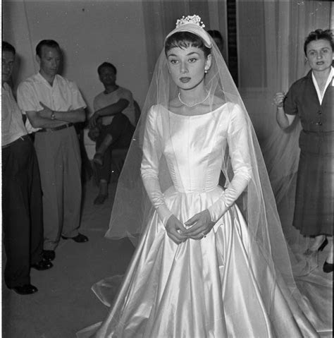Audrey tries on wedding dress, Rome,1952 ?   Audrey h in