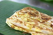 The final presentation of Roti Canai on banana leaf