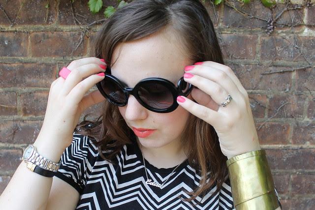 Missoni for Target chevron tee, neon embroidered skirt, black lace ballet flats, gold purse, Prada baroque sunglasses