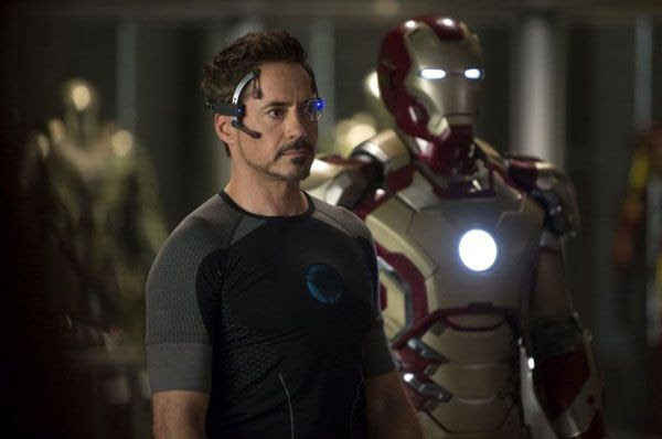 Tony Stark (Robert Downey Jr.) stands next to the Mark 42 armor in IRON MAN 3.