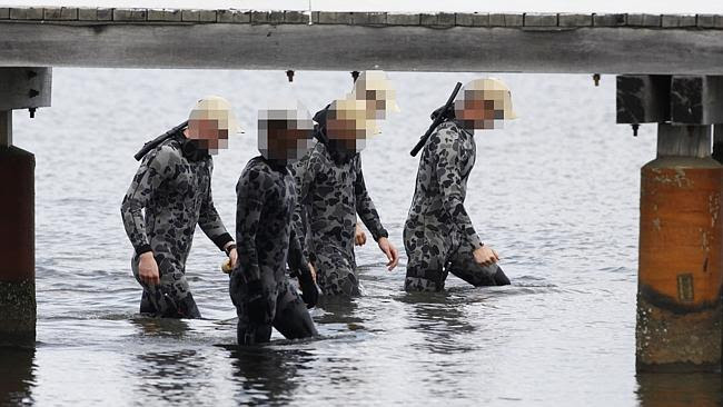 Police divers resume their search for the explosive. Picture: Jackson Flindell