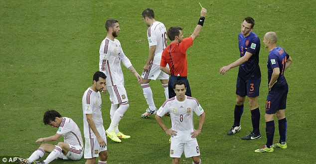Proceed with caution: De Vrij (second right) is shown the yellow card by Nicola Rizzoli