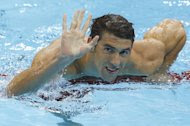 United States' Michael Phelps waves after finishing first in the men's 200-meter butterfly swimming semifinal at the Aquatics Centre in the Olympic Park during the 2012 Summer Olympics in London, Monday, July 30, 2012. (AP Photo/Daniel Ochoa De Olza)