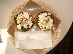 Rice bread with goat cheese, pesto, and pine nuts
