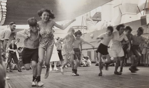 """A <a href=""""http://collections.museumvictoria.com.au/items/1753376"""">three-legged race</a> on a ship carrying migrants from Britain to Australia in 1947."""