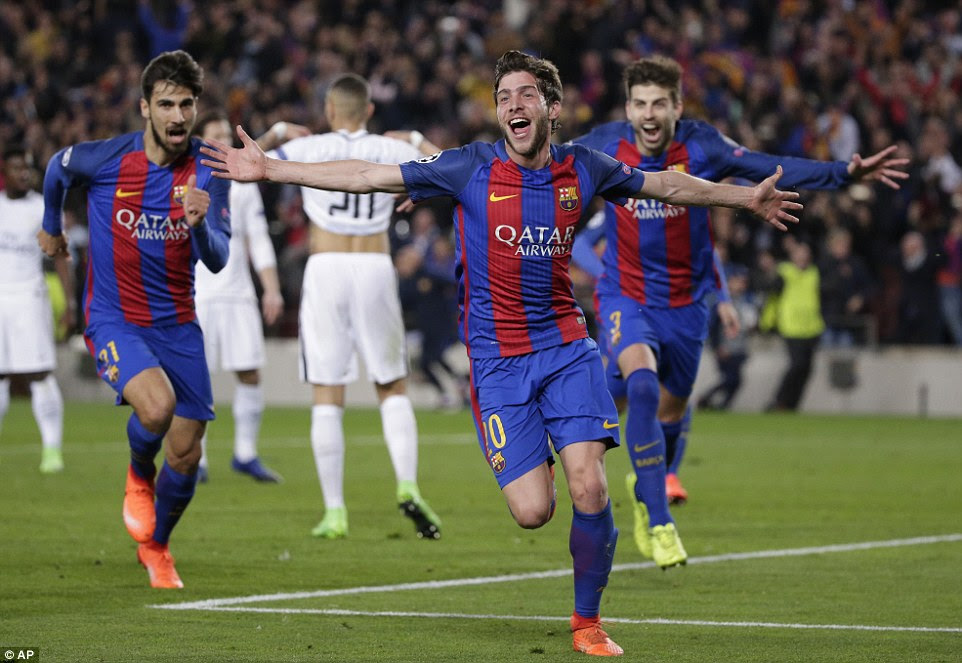 Sergi Roberto is chased by team-mates Andre Gomes and Gerard Pique as they rejoice in a miracle win at the Nou Camp