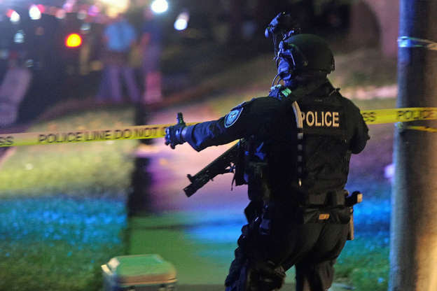 A Fort Worth Police SWAT member works in the Wedgwood neighborhood of Fort Worth, Texas, on Friday, Sept. 16, 2016, amid reports that two officers were shot.