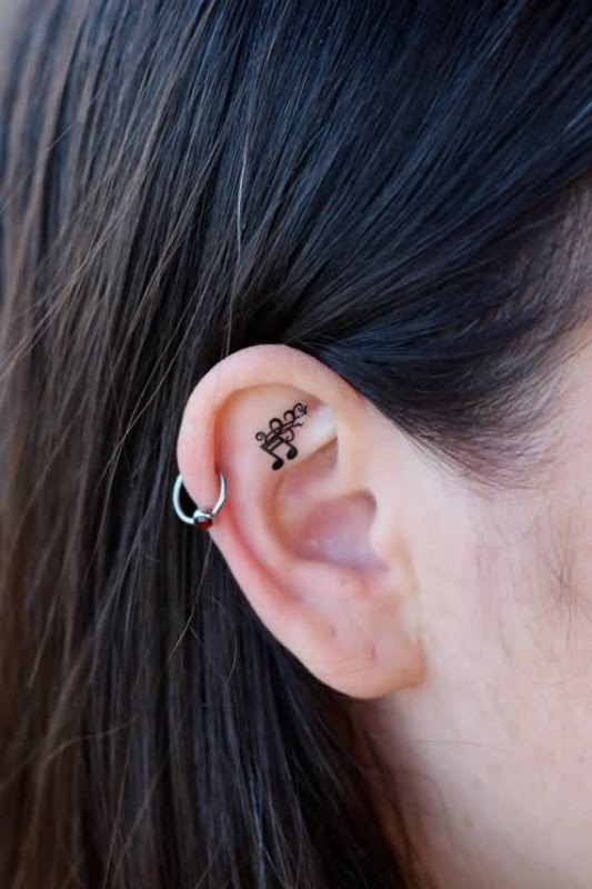Latest Black Ink Music Notes Tattoo Make On Behind Ear For Women