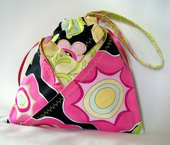 Pink, turquoise, yellow, black wristlet clutch